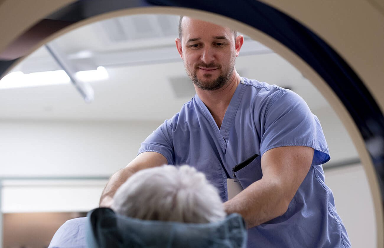 Doctor Guiding Patient through CT scan