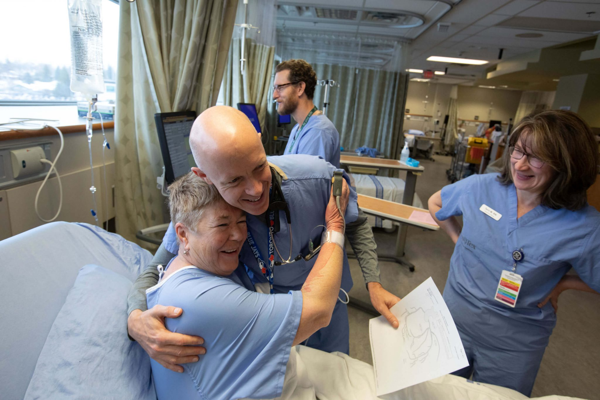 Cardiac doctor hugging patient at bedside