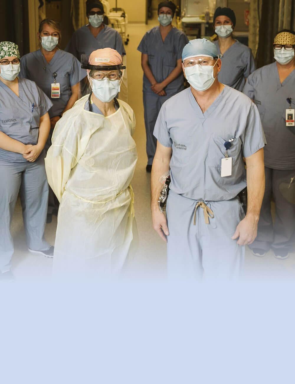 Hospital staff standing in hallway wearing masks