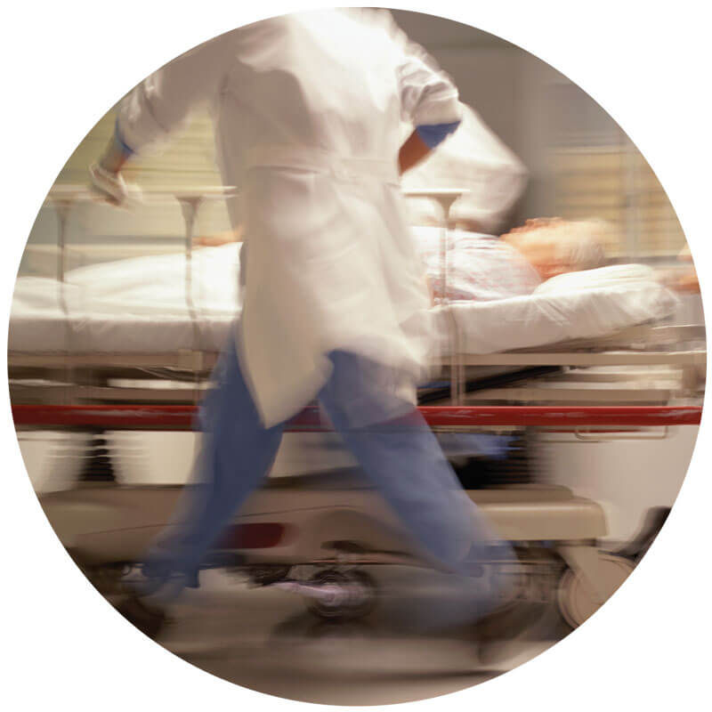 Blurred image of emergency room doctor pushing stretcher