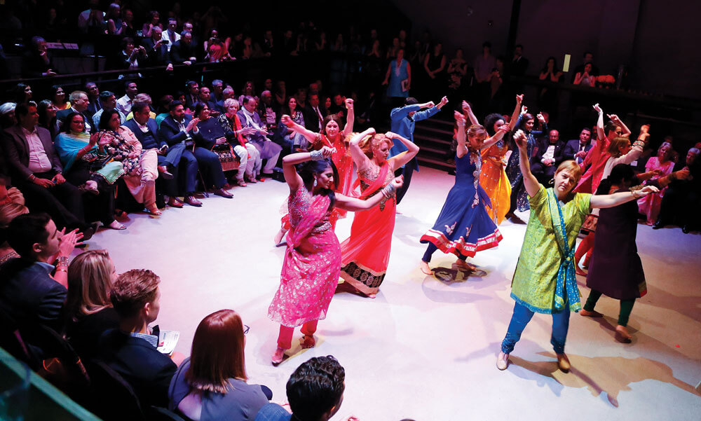 Dance performance with women in colourful East-Indian traditional clothing