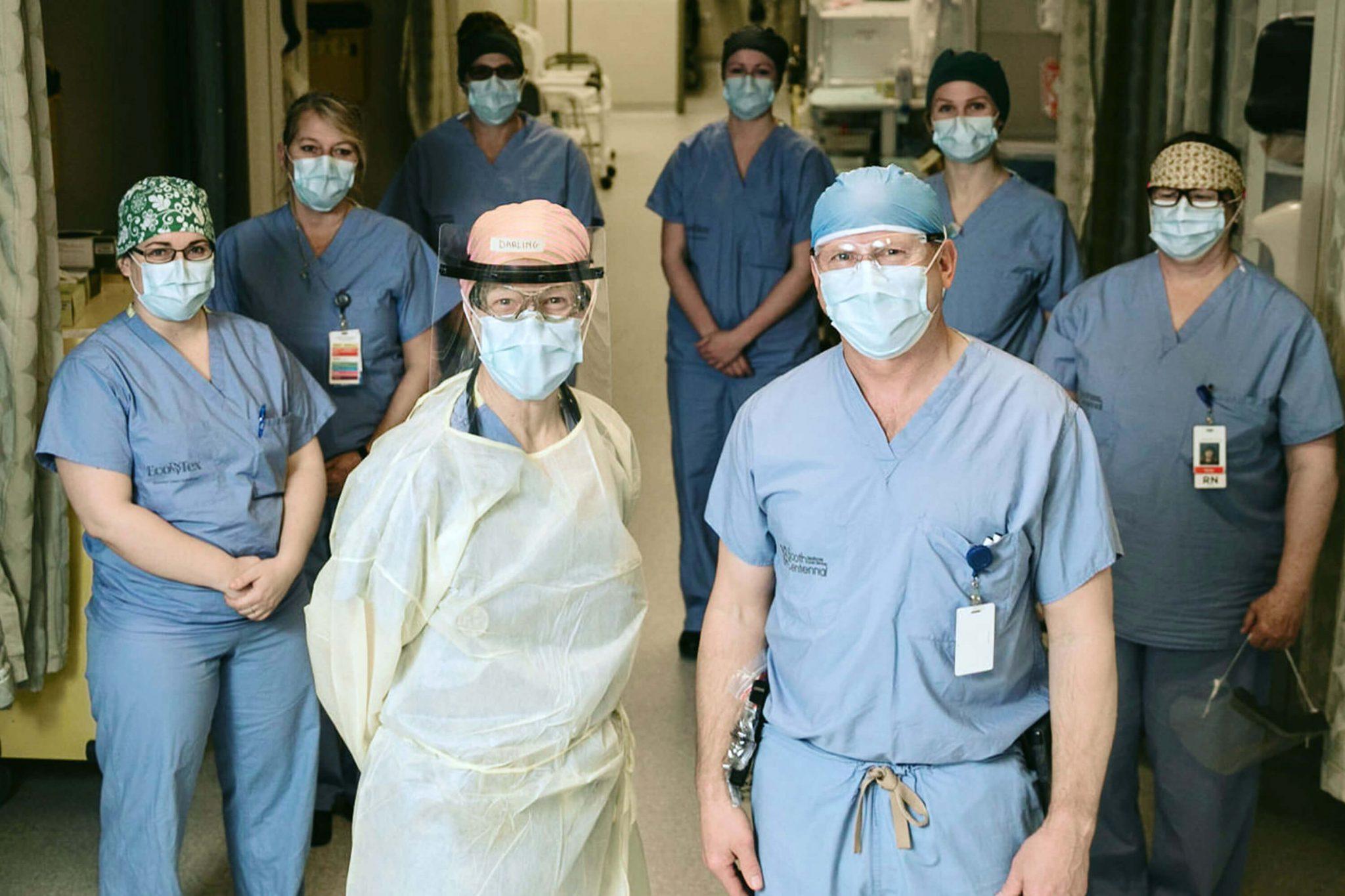 Masked doctors and nurses in hospital corridoor
