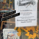 A window sign advertises a hair and art studio's fundraiser for the PRHC Foundation