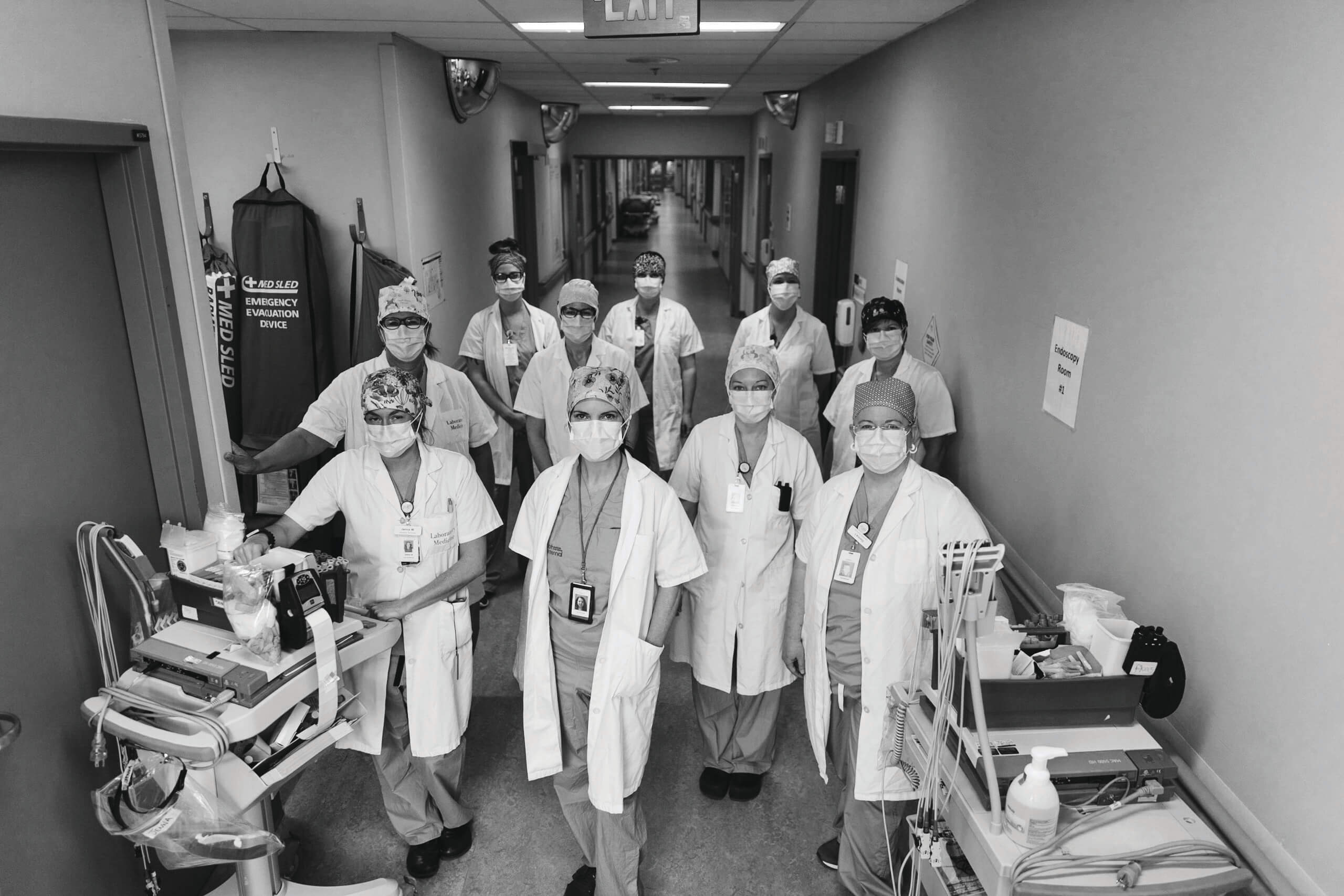 Laboratory Medicine Technicians stand with ECGs machines