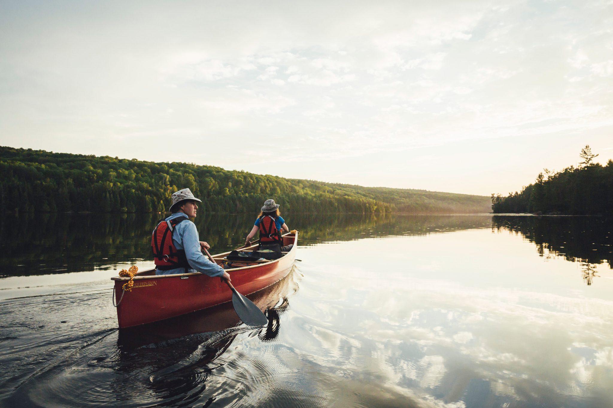 Canoe paddlers on a calm lake