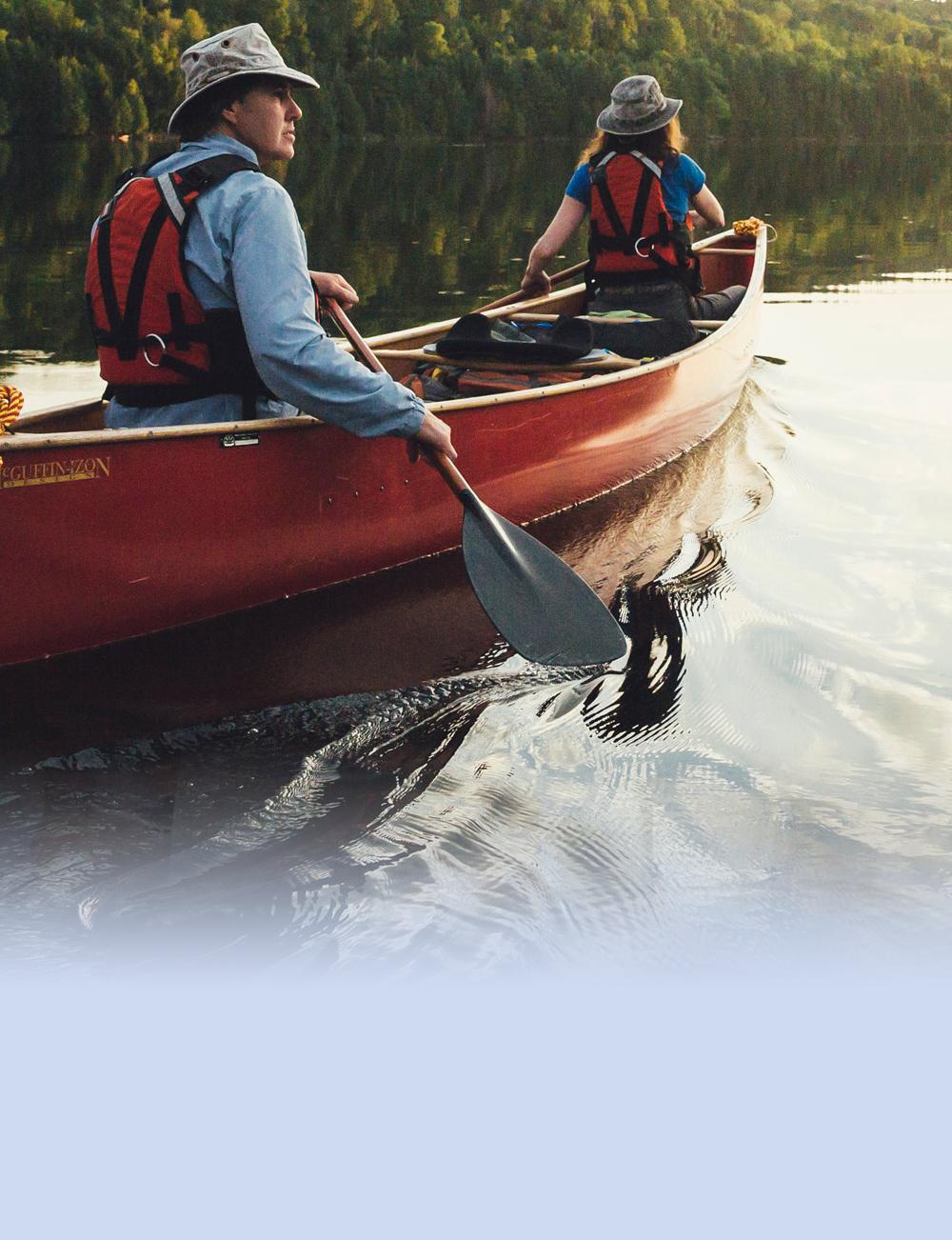 Canoe Paddlers on calm lake