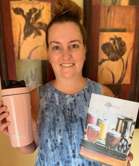 Amanda Johansen holds up some Sipology products